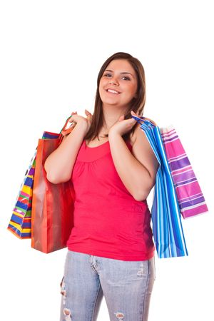 young happy brunette girl standing  with shopping paper bags photo