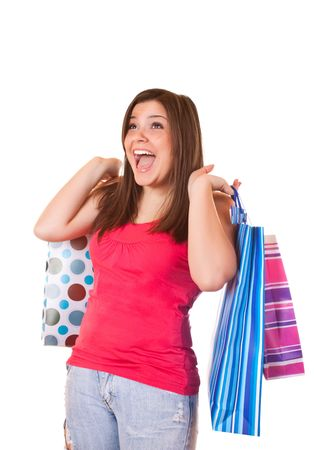 young happy brunette girl standing very satisfied with shopping paper bags  photo