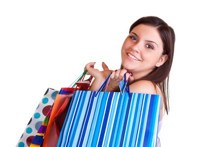 young  brunette girl standing  with shopping paper bags photo