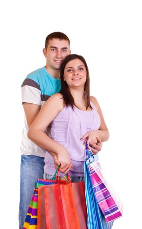 smiling happy young couple holding colorful shopping paper bags Stock Photo - 6465524