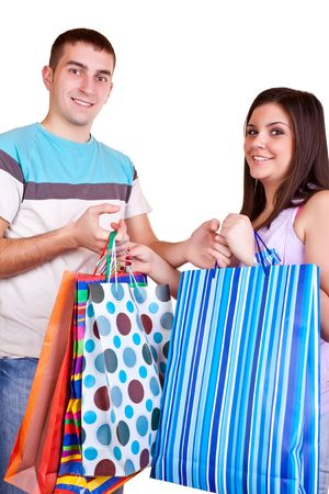 smiling happy young couple giving colorful shopping bags Stock Photo - 6465553