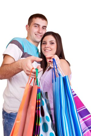 smiling happy young couple giving colorful shopping bags  Stock Photo - 6465570