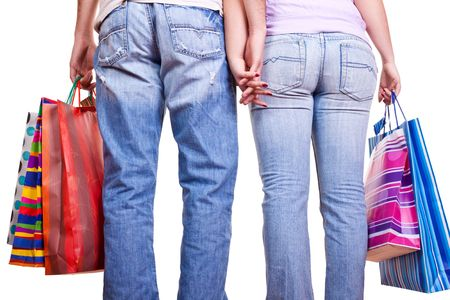 couple from back holding hands and carrying bags Stock Photo - 6465576