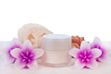 cream in white tube with flower candles sponge and seashell photo