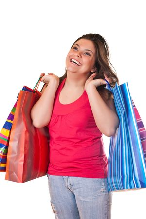 happy brunette girl very satisfied with shopping paper bags photo