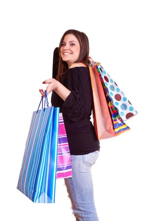 happy brunette girl standing  with shopping paper bags photo