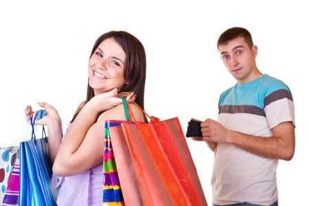 young man standing with wallet while woman standing with bags photo