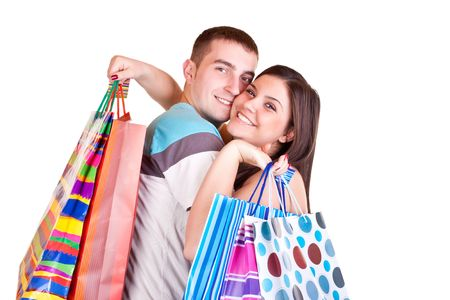 pretty young woman holding shopping paper bags and embracing boyfriend Stock Photo - 6540193