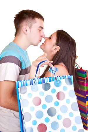 happy young couple kissing while holding colorful shopping paper bags Stock Photo - 6540227