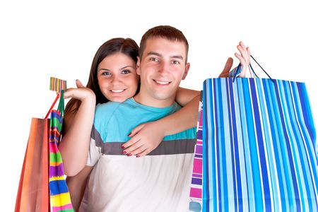 happy smiling  young couple holding  big shopping paper bags Stock Photo - 6540224