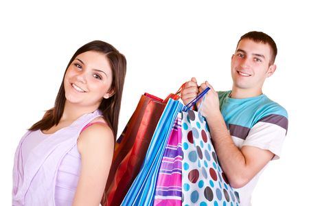 young happy brunette girl standing satisfied while man carrying shopping bags Stock Photo - 6540240