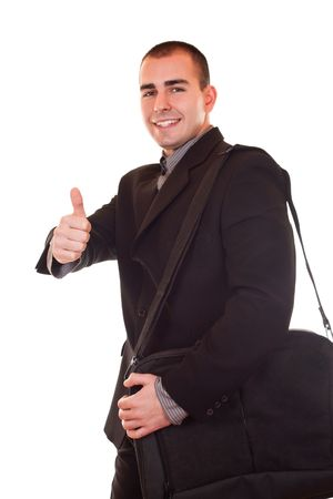 young attractive businessman standing with briefcase  holding thump up photo