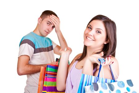 young man standing with wallet while woman standing with bags Stock Photo - 6599685