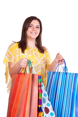 young  brunette girl holding  shopping paper bags photo