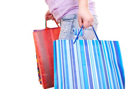close-up of a womens hands holding shopping paper bags  Stock Photo - 6606431