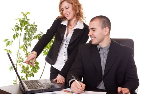 happy young businesswoman and businessman working together in office  photo