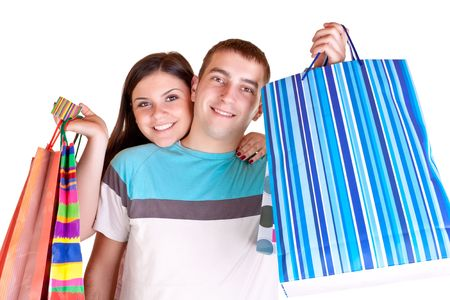 happy smiling  young couple holding  big shopping paper bags Stock Photo - 6635886