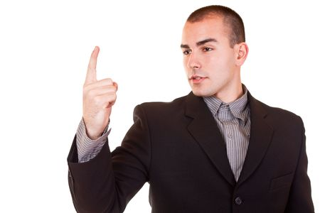 angry young businessman in black suit standing and threatening  photo