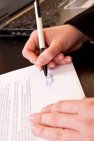 close-up of a woman hand holding pen and signing documents Stock Photo - 6667408