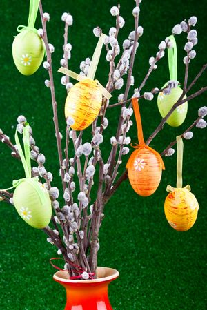 easter tree with colorful eggs on green background photo