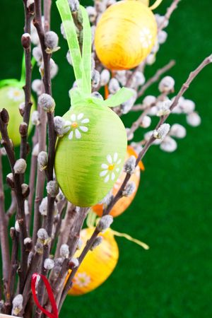 colorful easter eggs on pussy willow tree photo