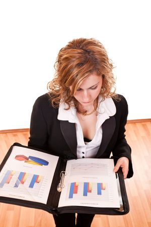 young attractive blond businesswoman holding and looking documents  Stock Photo - 6667715