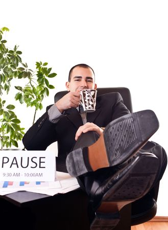 young successful businessman relaxing and drinking coffee on break photo