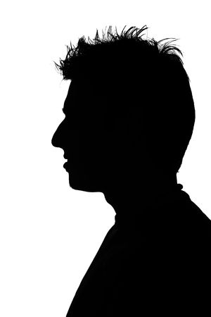 silhouette of a young man with funny hair photo
