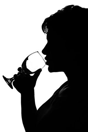 silhouette of a young woman drinking red wine photo