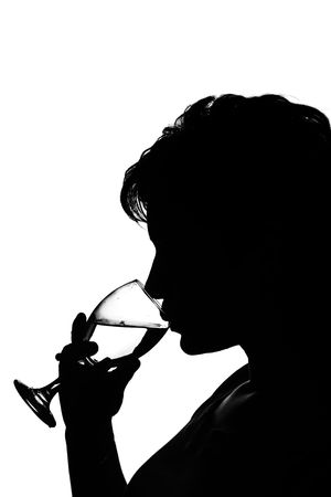 silhouette of a young woman with a glass of wine photo