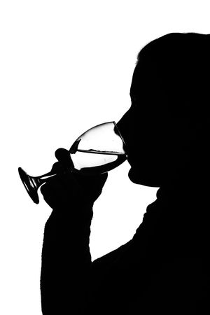 silhouette of a young woman and glass of wine photo