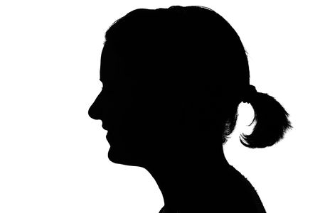 female form: silhouette of a happy girls profile isolated on white Stock Photo