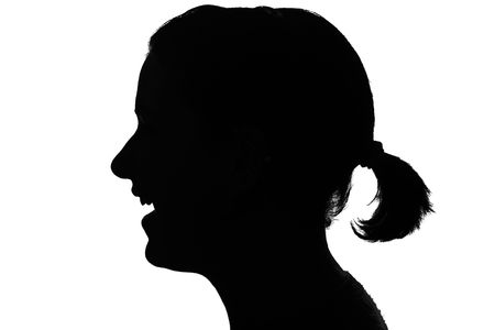 visage: silhouette of a smiling girls profile isolated on white