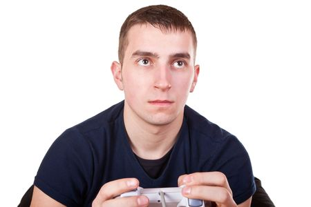 teenage guy: young serious teenage guy playing video games