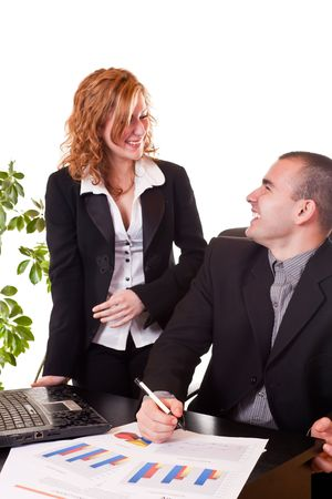 young happy business colleagues talking and laughing while working photo
