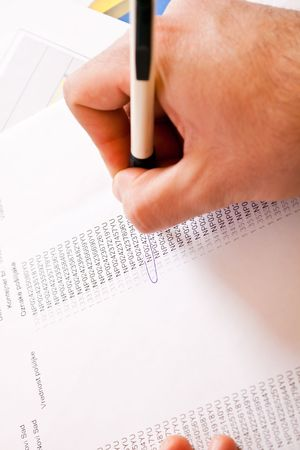 close-up of a mans hand circulating text with pen on paper Stock Photo - 6799941