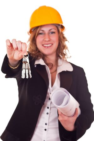 businesswoman with yellow helmet and paper holding keys photo
