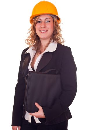 young attractive businesswoman standing with briefcase  and helmet Stock Photo - 6820250