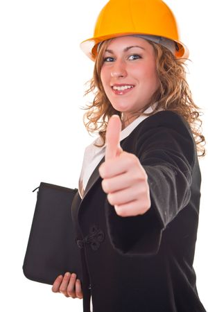 young attractive businesswoman with helmet holding thumb up photo