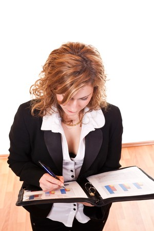 young attractive successful blond businesswoman writing on documents Stock Photo - 6928035
