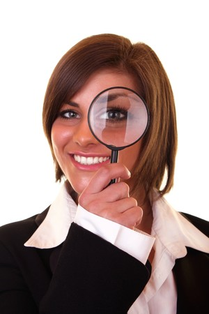 smiling businesswoman looking through a magnifying glass Stock Photo - 6928197