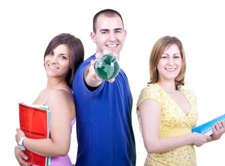 holding globe: tre giovani studenti attraenti con libri azienda globo  Archivio Fotografico