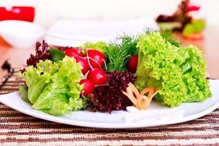 decorated vegeterian food on plate  - salad, radish, carrot Stock Photo - 7142785