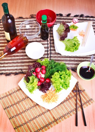 vegeterian: table with plate, vegeterian food, sauce, oil and wine