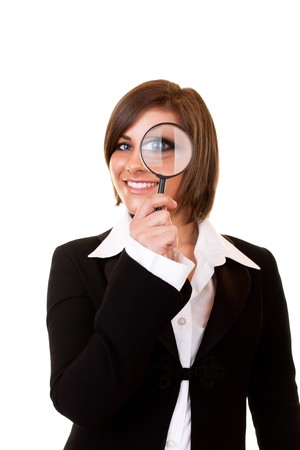 happy businesswoman looking through a magnifying glass photo