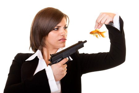 young  dangerous woman holding one gold fish and gun photo