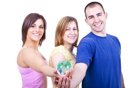 portrait of three smiling students holding globe in hands photo