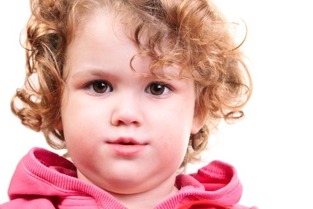 close-up of a cute little girl with beautiful curly hair  photo
