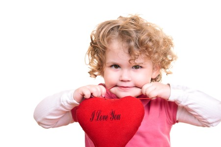 little girl with curly blond hair holding heart  photo