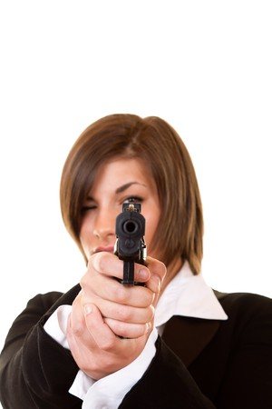 close-up of a  woman holding pistol pointing focusing on you photo
